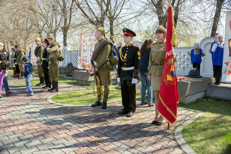 Patriotic youth stand in the guard of honor with a regimental colour in the Victory Memorial during the celebration of Victory Day. KRASNOYARSK, Krasnoyarsk stock image