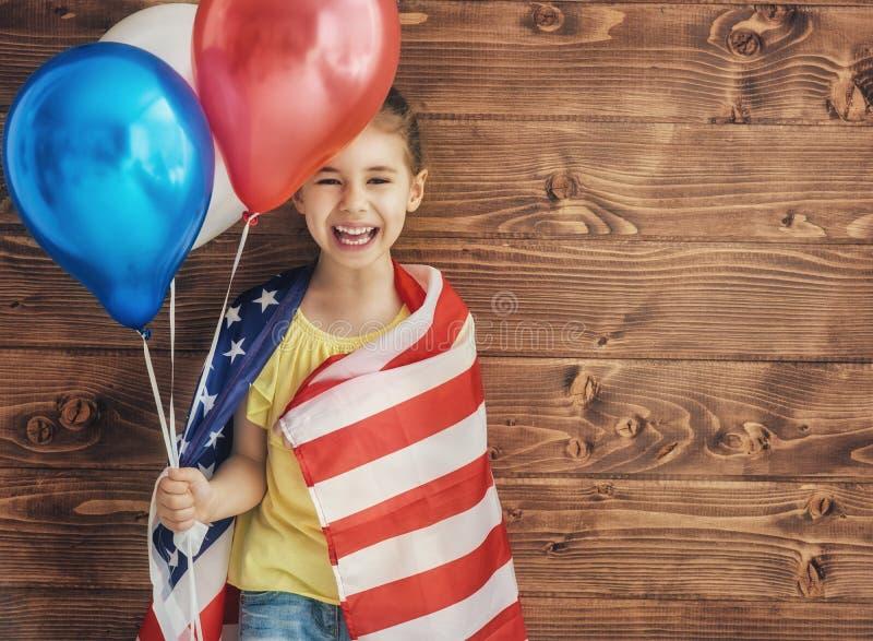 Patriotischer Feiertag und glückliches Kind stockbilder