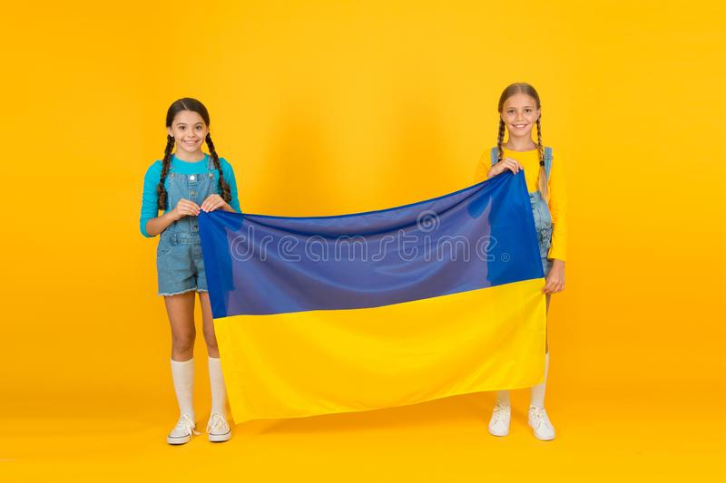Patriotism respect and love to motherland. National identity concept. Ukrainian kids. Girls with blue and yellow flag stock images