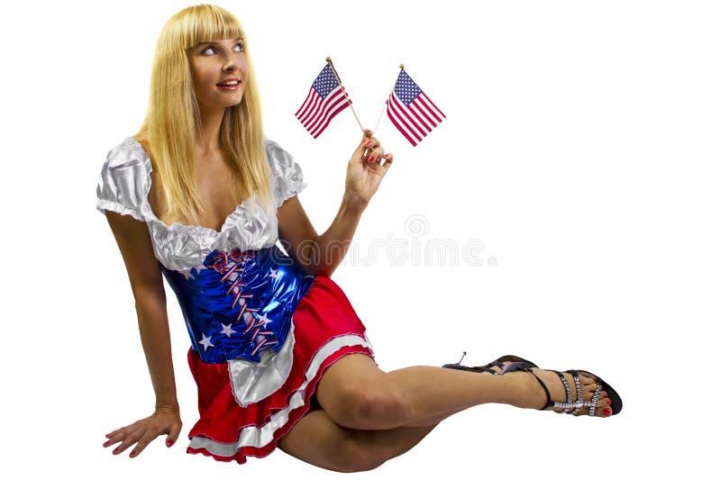Patriottisch Amerikaans Meisje met twee vlaggen stock fotografie