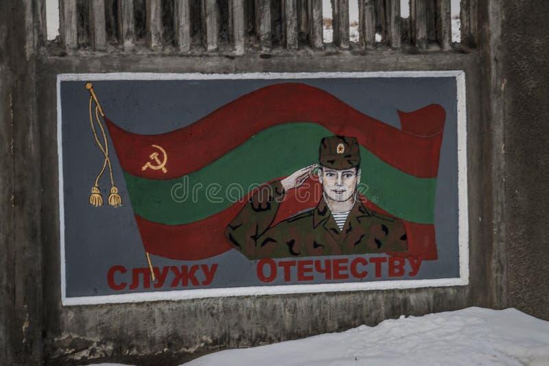 Patriottische Communistische Legermuurschildering in Buigmachine, Transnistria stock afbeeldingen