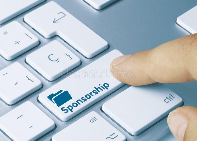 Patrocínio - Inscrição na tecla do teclado azul fotografia de stock