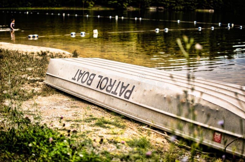 Patrol boat at lake. An aluminum patrol boat at a lake royalty free stock photos