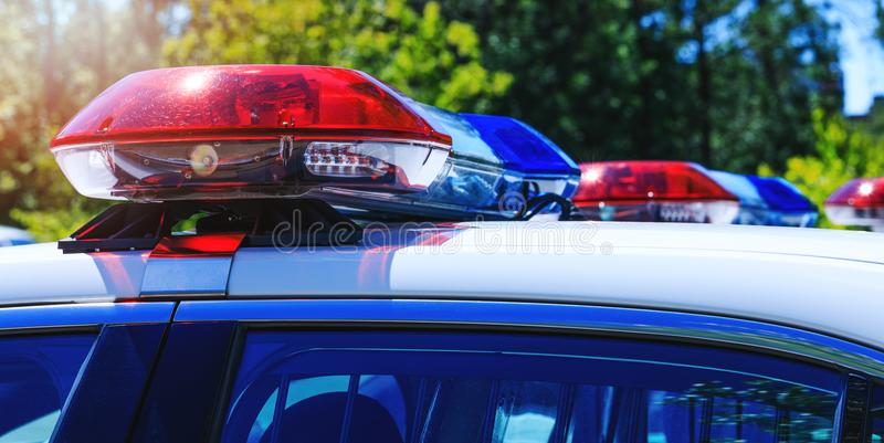 Patrol police car with beautiful emergency sirens lights. Canadian policemen in traffic control activity. A police raid for royalty free stock photography