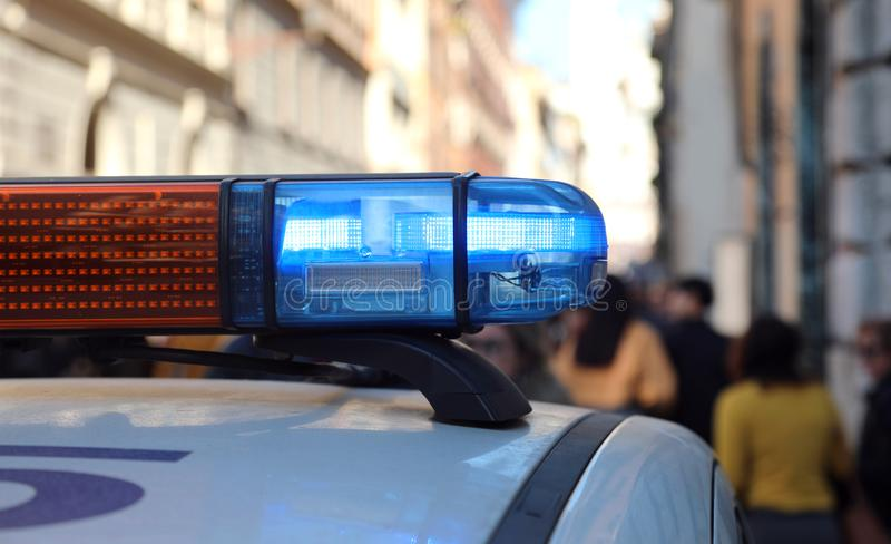 Patrol police car with blue light of sirens. In the city stock photography