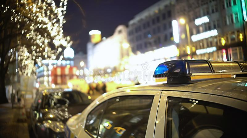 Patrol police car on city street at night, public order protection, security stock image