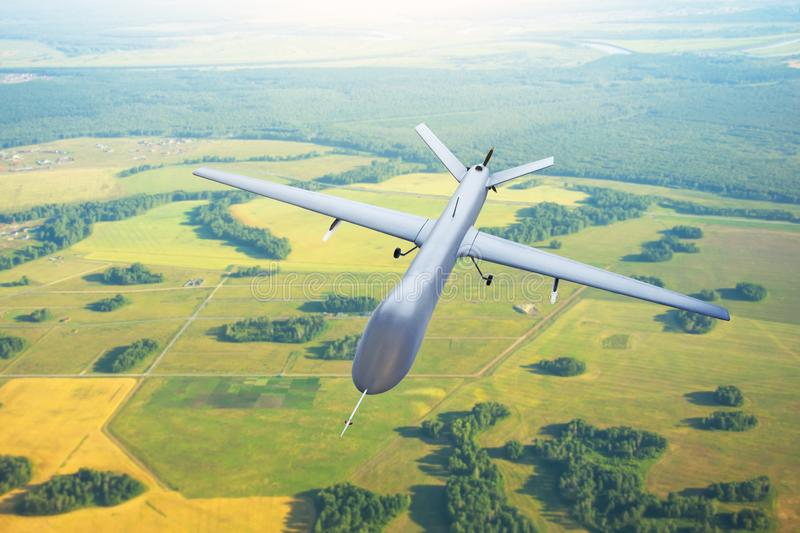 Patrolling unmanned aircraft in the sky above the terrain, fly tracking. stock photos