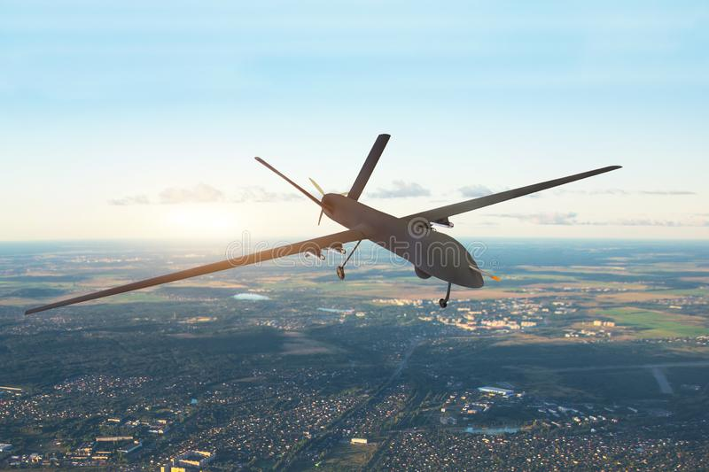 Patrolling unmanned aircraft in the sky above the terrain, fly tracking. royalty free stock photos