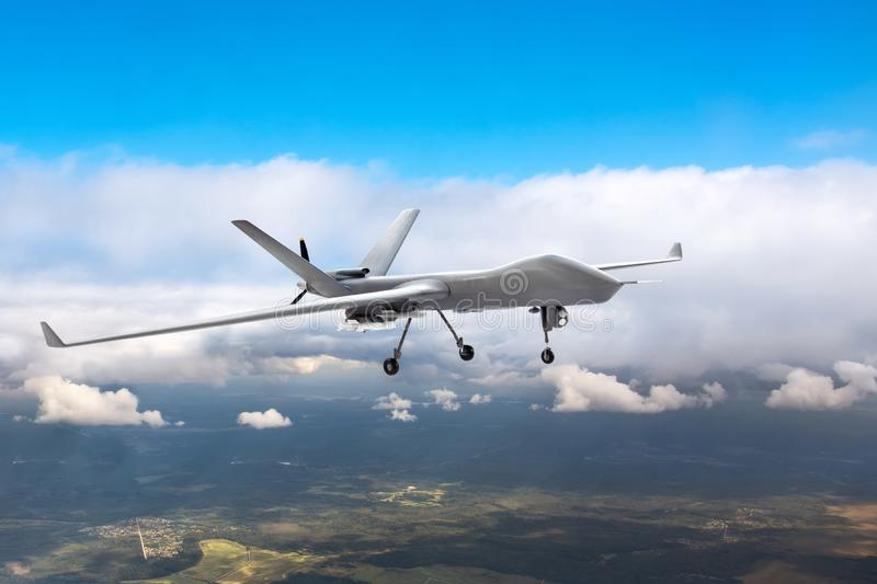 Patrolling unmanned aircraft in the sky above the terrain, fly tracking royalty free stock image