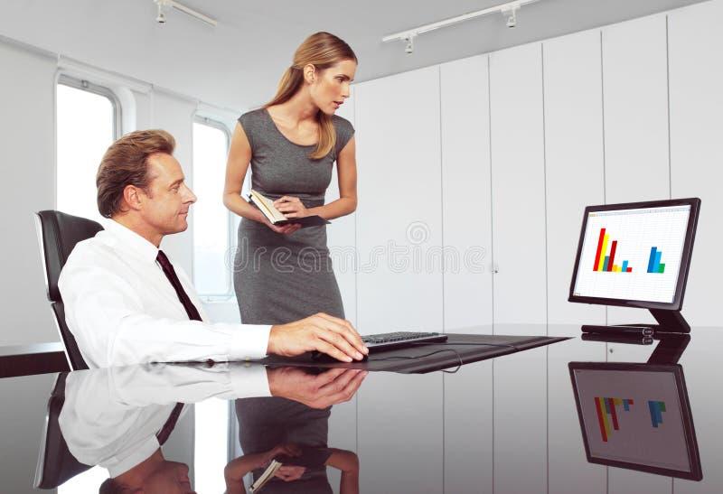 Patron et secrétaire photo stock