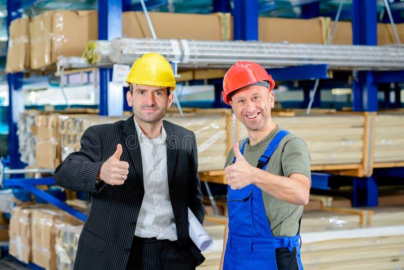 Patron et travailleur avec le pouce  images stock