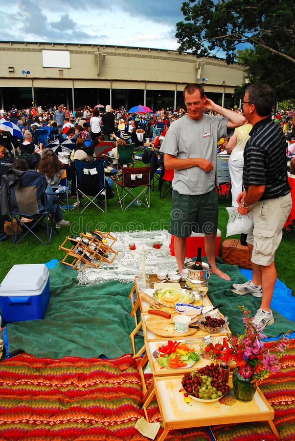A pre-concert picnic at a Music Festival. Patrons enjoy a pre-concert picnic at Tanglewood Music Festival  Near Stockbridge, Massachusetts stock photo