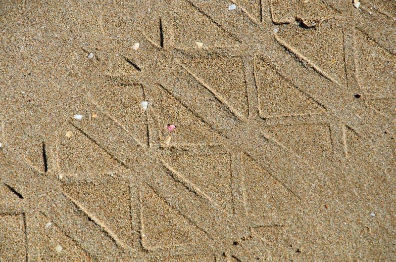 Patroon op het zand op een strand stock fotografie