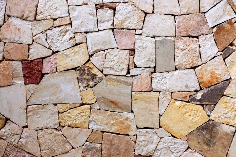 Patroon van de decoratieve kleurrijke achtergrond van de steenmuur De textuur abstracte muur van de steenmuur royalty-vrije stock foto