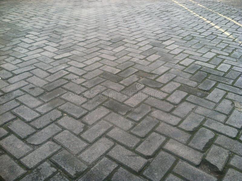 Patroon van Gray Paving Block Road stock fotografie