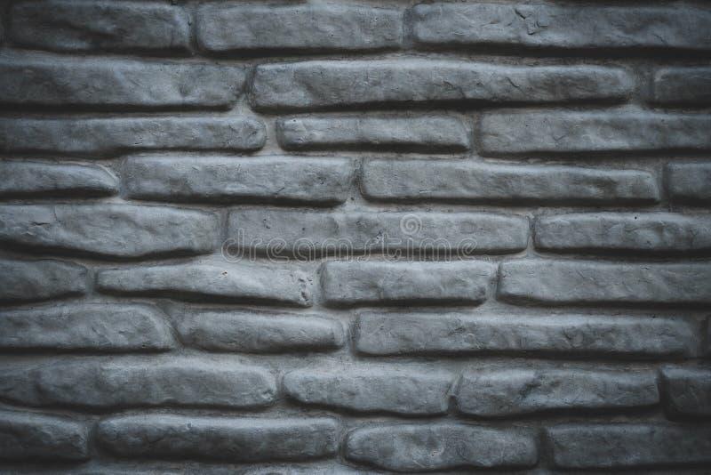 Patroon van grijze steenachtergrond De grijze achtergrond van de bakstenen muurtextuur Uitstekende huisvoorgevel De grijze textuu stock foto's
