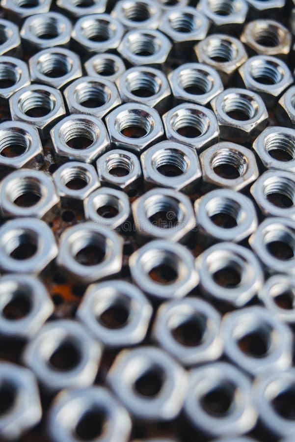 Patroon van metaalnoten stock afbeelding