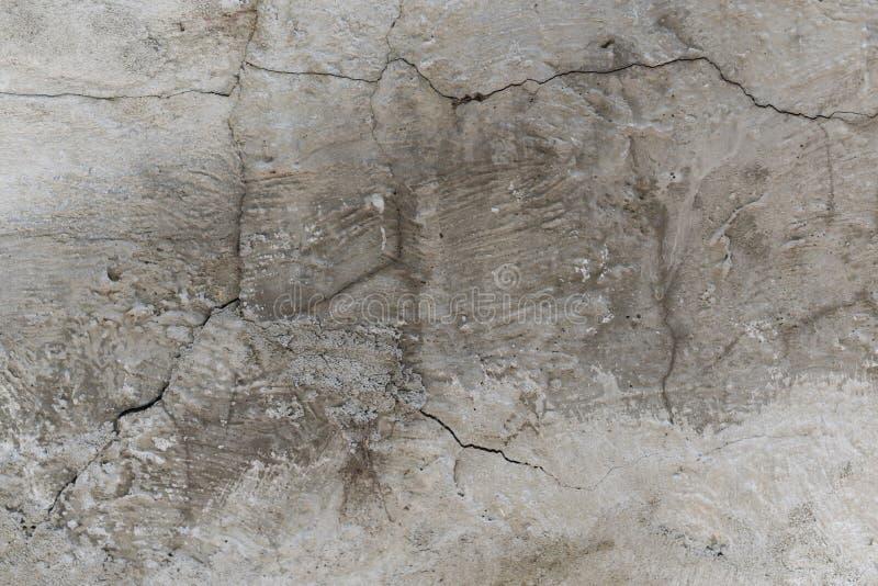 Patroon van verfschil weg op oud pleister met vuil, textuur van grungemuur Gekraste laag op oppervlakte van beton Textuur royalty-vrije stock foto's