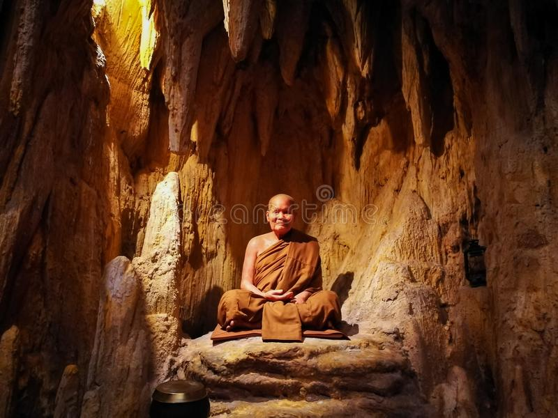 Pattaya Chonburi, Thailand, 27 July 2017 : the wax figure of Thai venerable monk in the cave royalty free stock photo