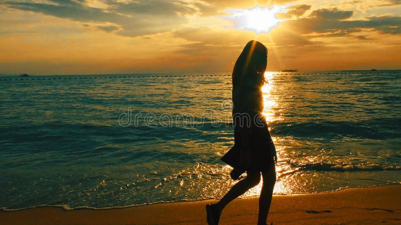 Pattaya Jomtien Beach Thailand. Female. At the beach at the sunset royalty free stock images