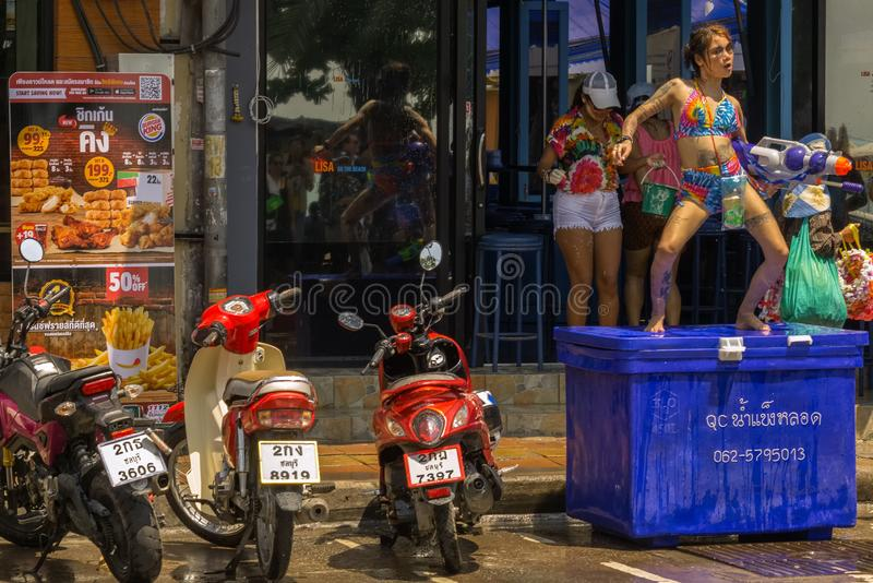 Thai girls were celebrating Songkran in front of a near bar called Lisa On The Beach royalty free stock photography