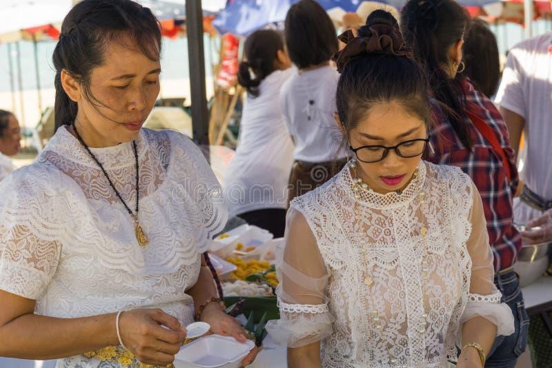 Two Thai women in white dresses prepared delicious Thai food royalty free stock image