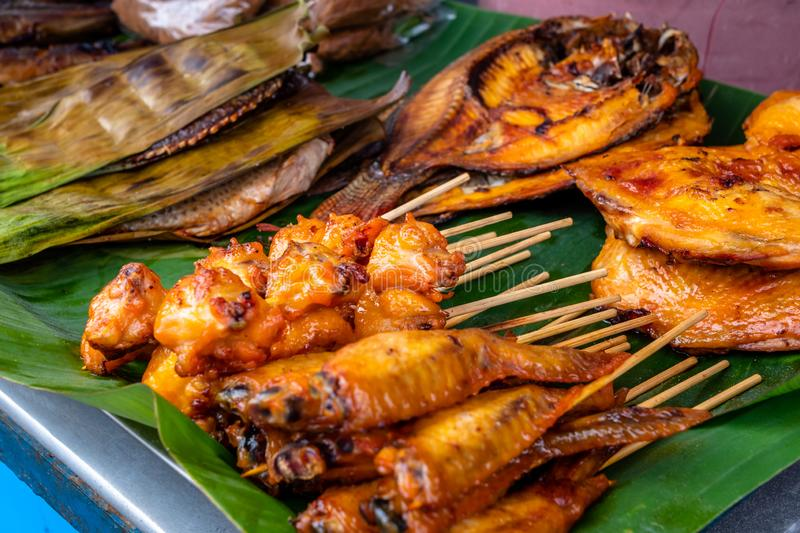 BBQ Street food grilled right at the side of the road fresh. Many Thai people eat as a cheap snack between meals. Pattaya, Thailand - August 1, 2019: BBQ Street royalty free stock photography