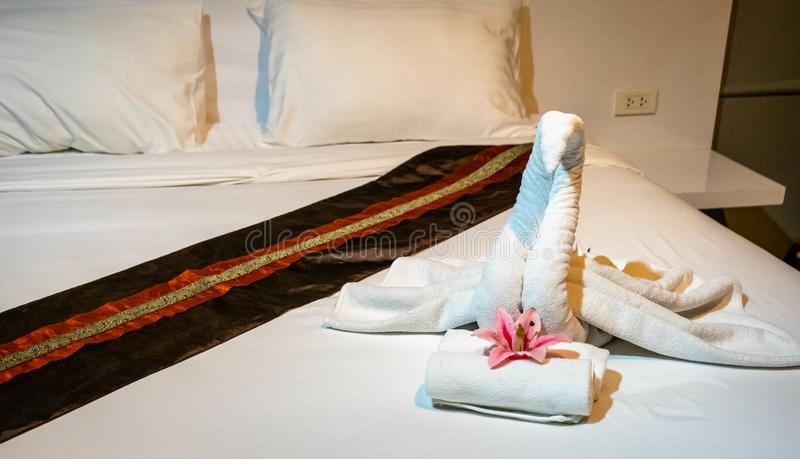 Luxury Boutique Hotel Swan Towel Art. Very romantic and a nice surprise welcome to the vaction royalty free stock photo