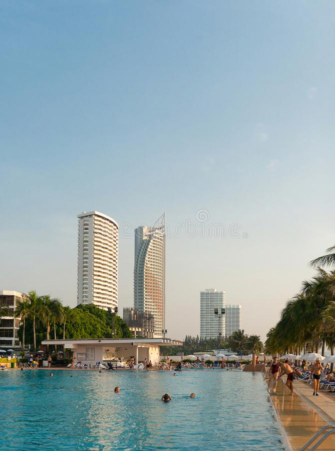 Pattaya, Thailand, December 03, 2018: - People relax by the pool at the Ambassador City Jomtien hotel. Pattaya, Kingdom of Thailand, December 03, 2018: - People stock images