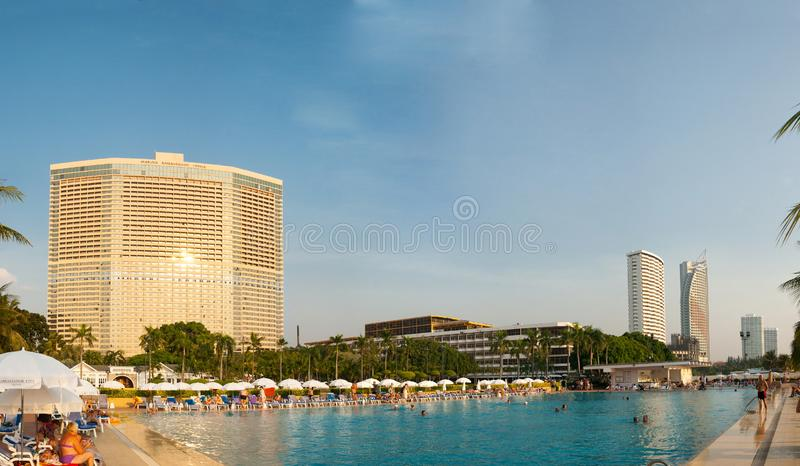 Pattaya, Thailand, December 03, 2018: - People relax by the pool at the Ambassador City Jomtien hotel. Pattaya, Kingdom of Thailand, December 03, 2018: - People royalty free stock photos