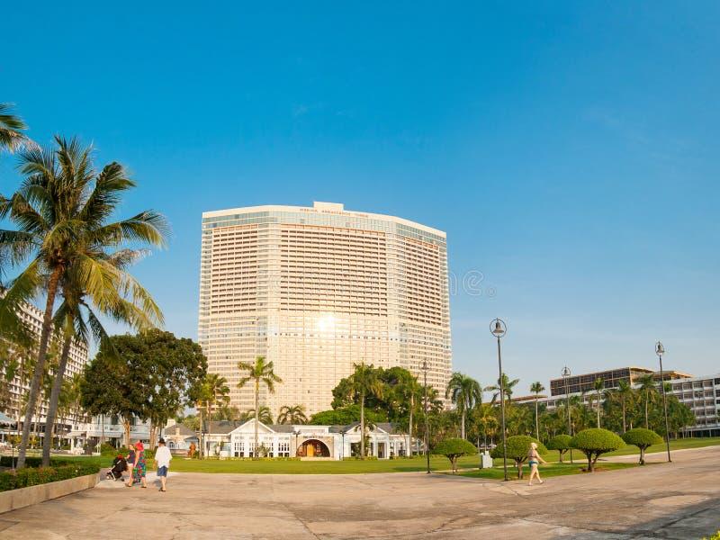 Pattaya, Thailand, December 03, 2018: - People walk in the territory of the hotel Marina Ambassador Tower. Pattaya, the Kingdom of Thailand, December 03, 2018 royalty free stock photo
