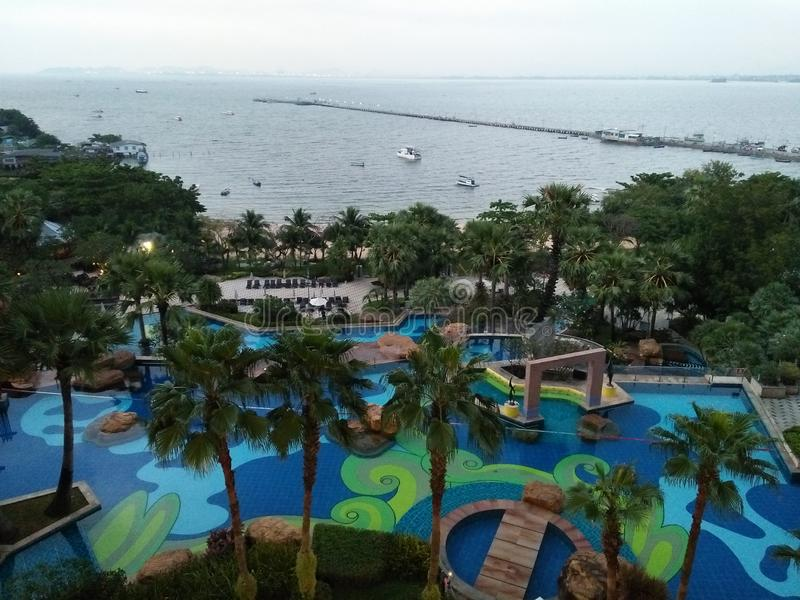 PATTAYA, THAILAND - Nov,30 2018: View of swimming pool at The Zign Hotel,luxury hotel and Pattaya sea stock photography
