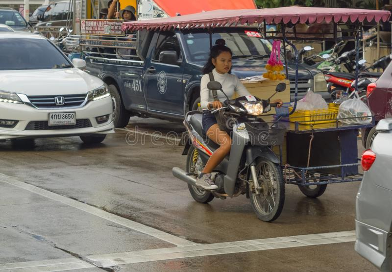 PATTAYA,THAILAND - OCTOBER 14,2018: Beachroad A young Thai woman is driving her mobile kitchen stock images