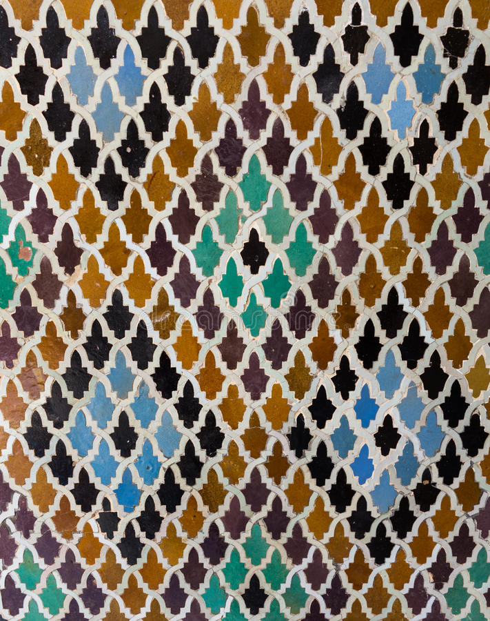 Pattern of arabic tiling or mosaic. Oriental pattern mosaic of tiles in a mosque in Morocco forming diamond shapes stock images
