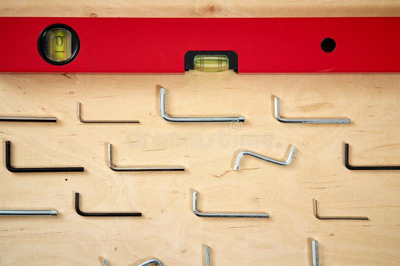 Pattern background of various allen keys with level spirit on wooden work table stock images