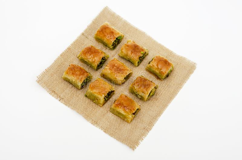 Pattern with baklava on fabric. Sweets abstract background. Baklava on the white background. stock photography