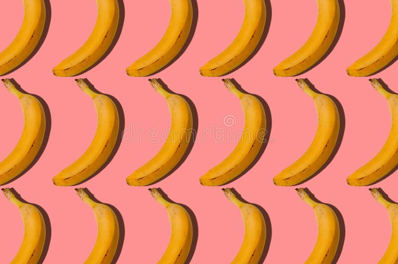 Pattern. Banana concept. Group of bananas on pink background. C stock images