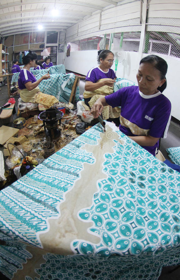 Pattern of batik using a canting. Traditional batik craftsmen worked on the cultivation pattern of batik using canting in Ndalem Wuryaningratan Surakarta royalty free stock images