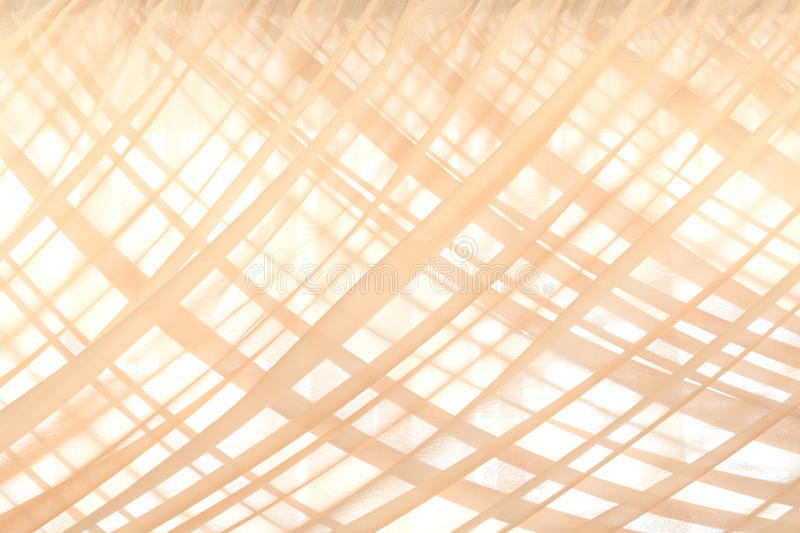 Pattern of beige fabric curtains as the background royalty free stock photos
