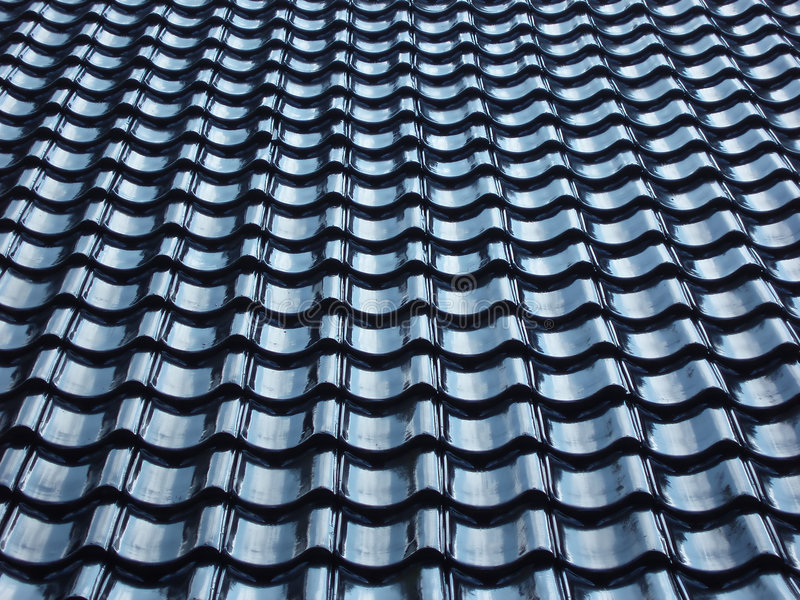 Pattern of black tiled roof. Background royalty free stock photo