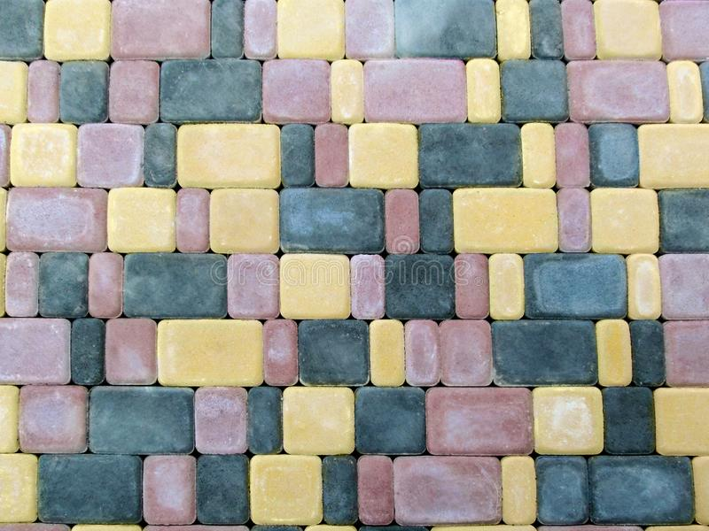 The pattern of the blank surface of the multi-colored paving tiles royalty free stock photography
