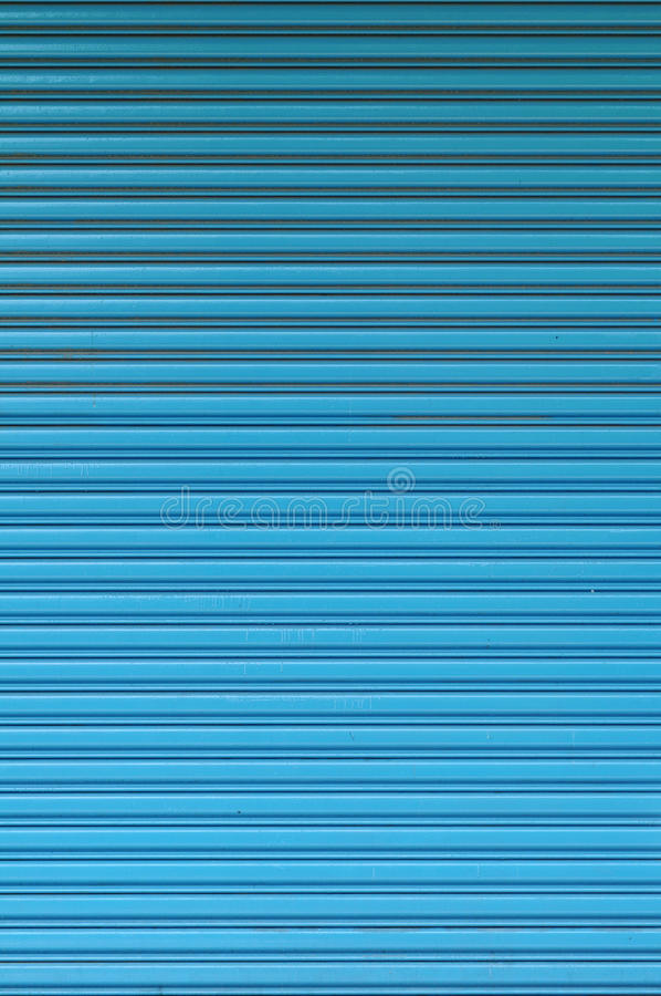 Pattern of blue roll up door royalty free stock photo