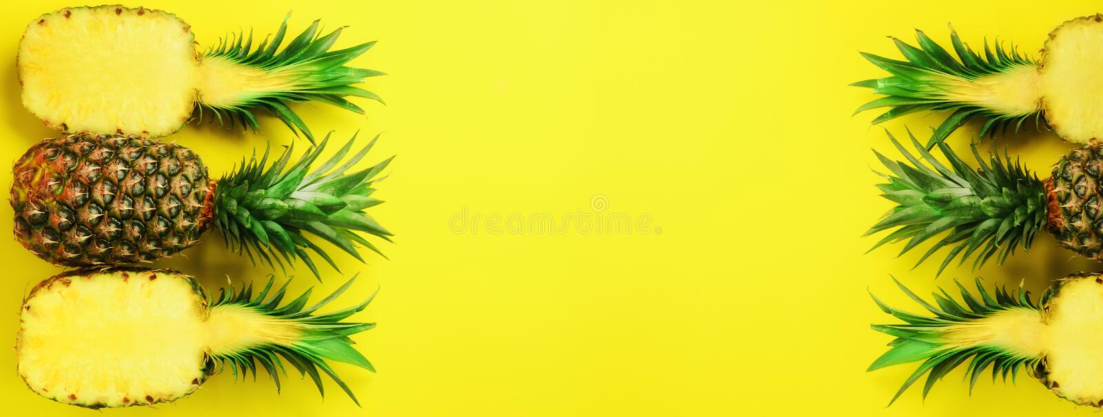 Pattern with bright pineapples on blue background. Top View. Copy Space. Minimal style. Pop art design, creative summer. Concept royalty free stock images