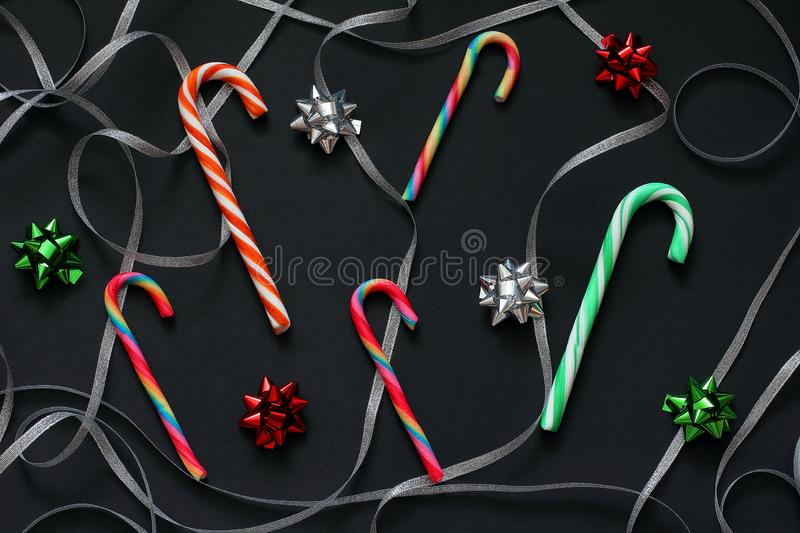 Pattern of candy cane christmas, swirls of silver ribbon and bows for gifts green, red and silver colors. Christmas decorations stock image