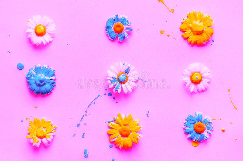 Pattern of chamomiles painted blue and yellow paints royalty free stock photos