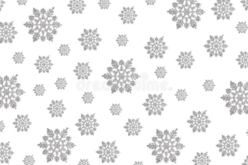 Pattern of Christmas decor in the form of silver snowflakes on a white background. new year concept, top view, flat layout stock photo