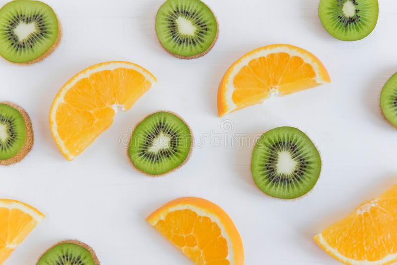 Pattern of citrus. Kiwi and orange slices on white wooden background. Fresh and natkralnye vitamins. Healthy food. Flat lay, top. Pattern of citrus. Kiwi and royalty free stock photography