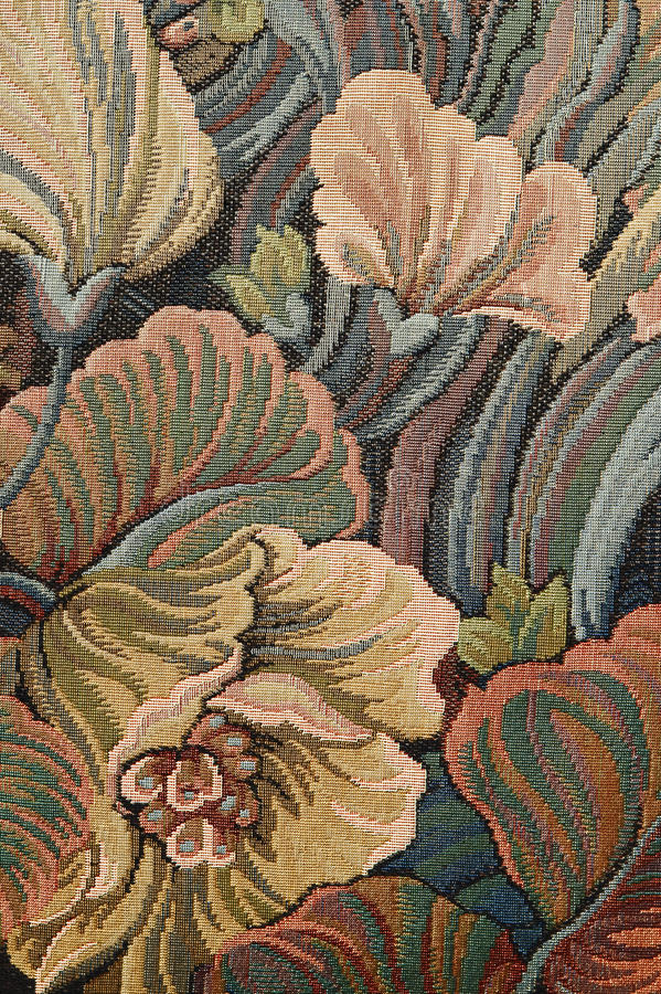 Pattern of a classical ornate floral tapestry. Closeup of retro tapestry fabric pattern with colorful floral ornament in classical style stock image