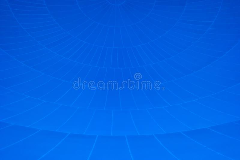 Pattern of converging lines on a dome with blue background stock illustration