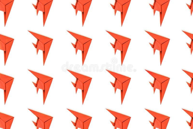 Paper origami fishes isolated on white background. Pattern of coral paper origami fishes isolated on white background stock photo